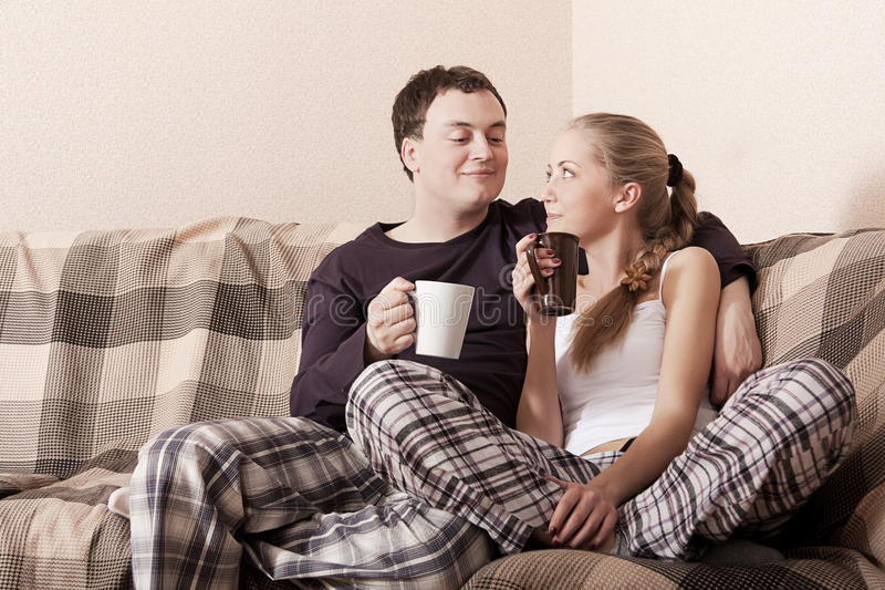 Young couple on a couch royalty free stock images