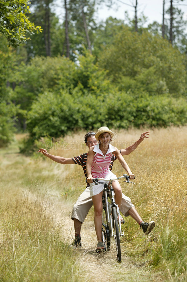 Young couple cycling stock photography