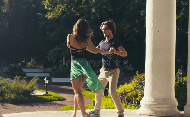 Young couple dancing in the park royalty free stock images