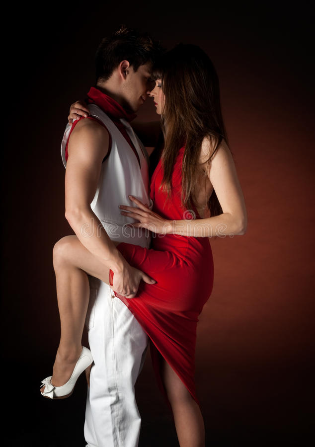 Free Young Couple Dancing Passion On Dark Red Light Royalty Free Stock Photos - 14126148
