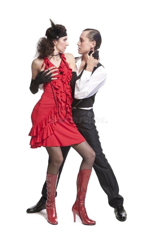 Young couple dancing tango stock image