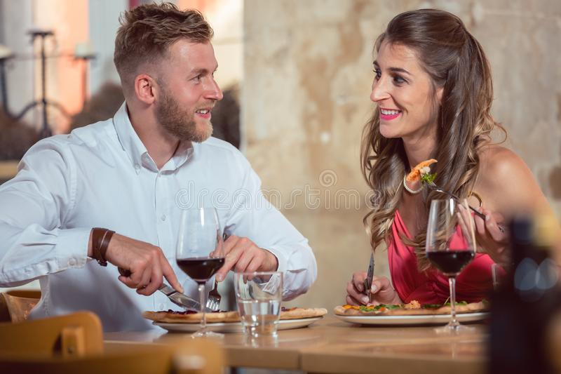 Young couple dining together stock photos