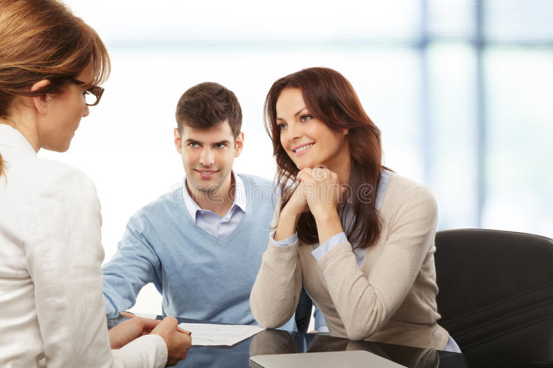 Young couple discussing financial plan with consultat royalty free stock photo