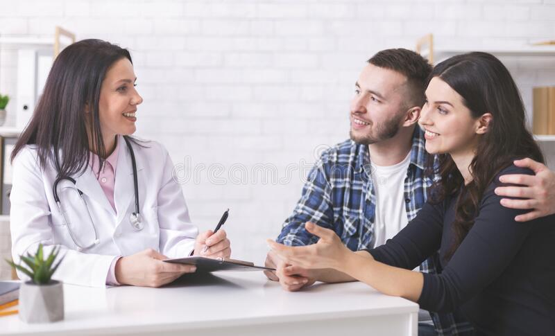 Young couple at doctor`s appointment at clinic. Family consultation. Young couple at doctor`s appointment at clinic, panorama, free space royalty free stock image