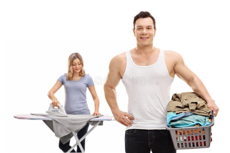 Young couple doing housework stock photo