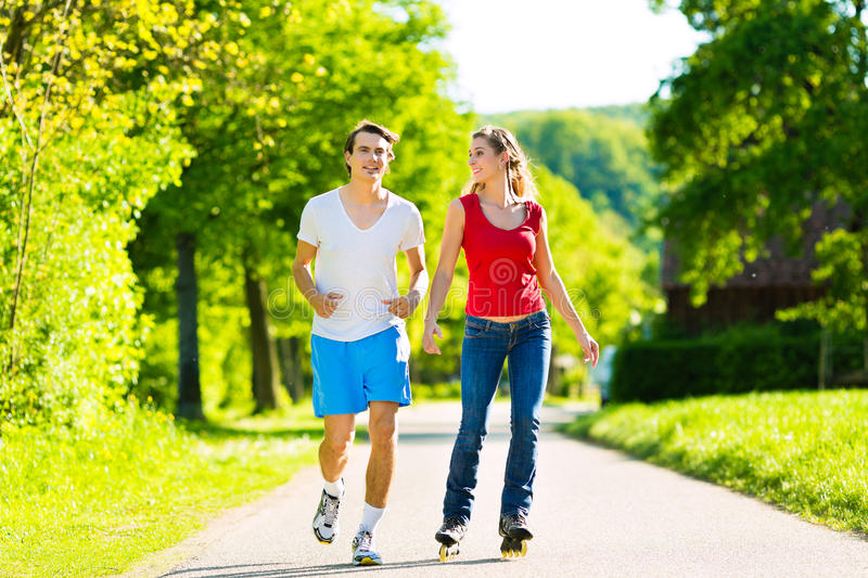 Download Young Couple Doing Sports Outdoors Stock Photo - Image: 25272494