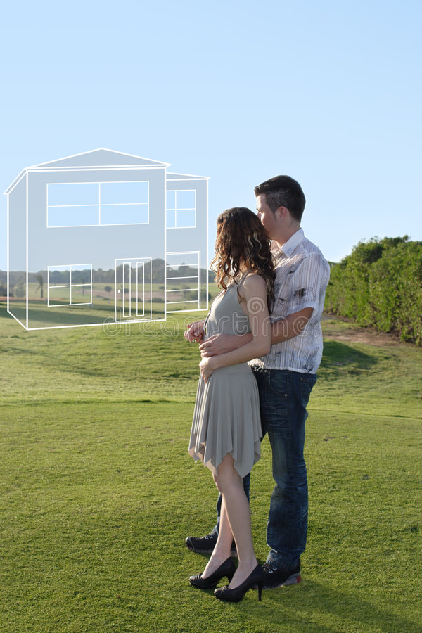 Young couple dreaming about a house stock images