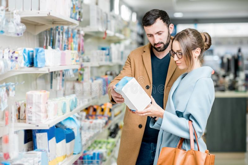 Couple in the pharmacy store royalty free stock images