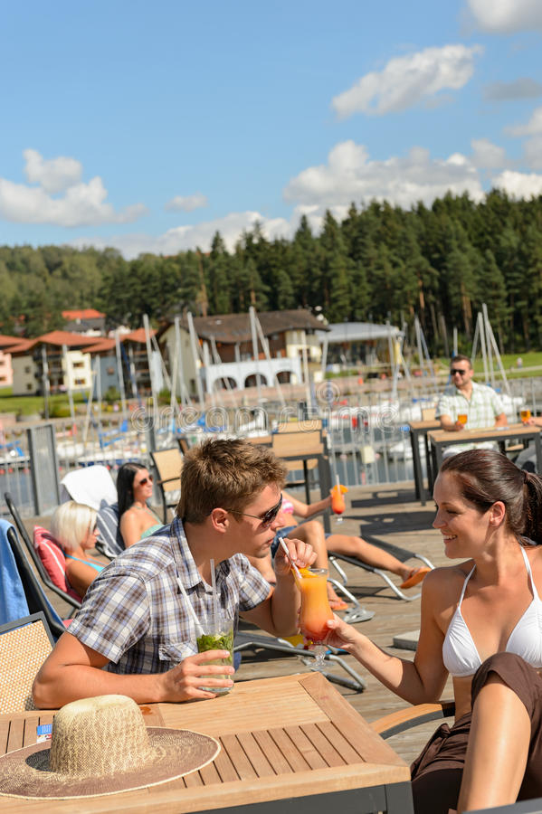 Download Young Couple Drinking Cocktail At Beach Bar Stock Image - Image: 30174839