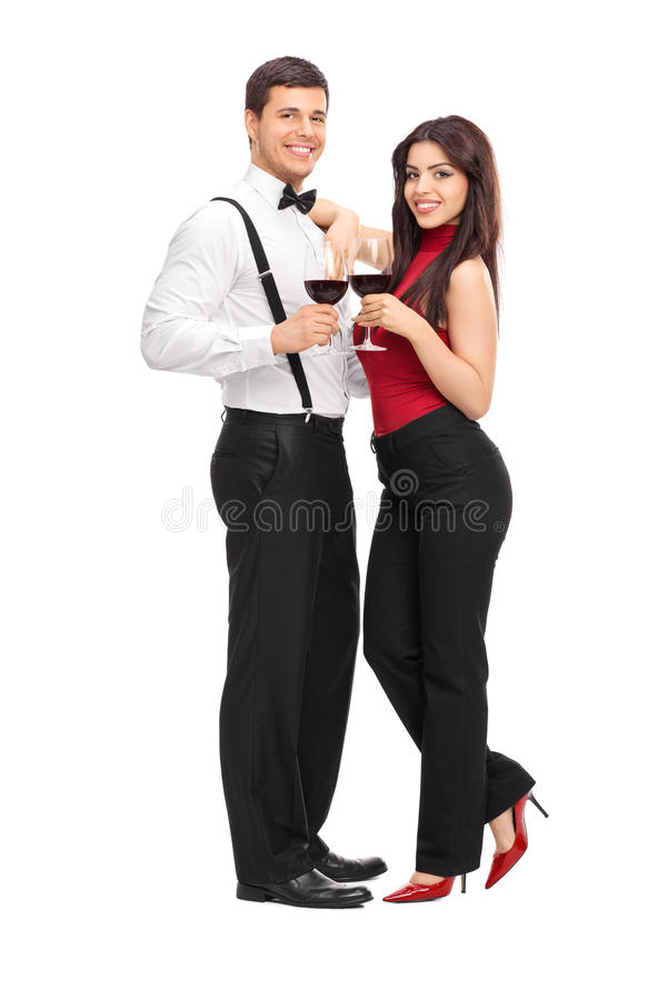 Young couple drinking red wine and posing stock photo