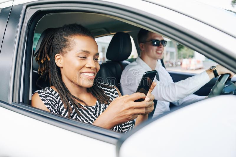 Young couple driving in car in the city royalty free stock image
