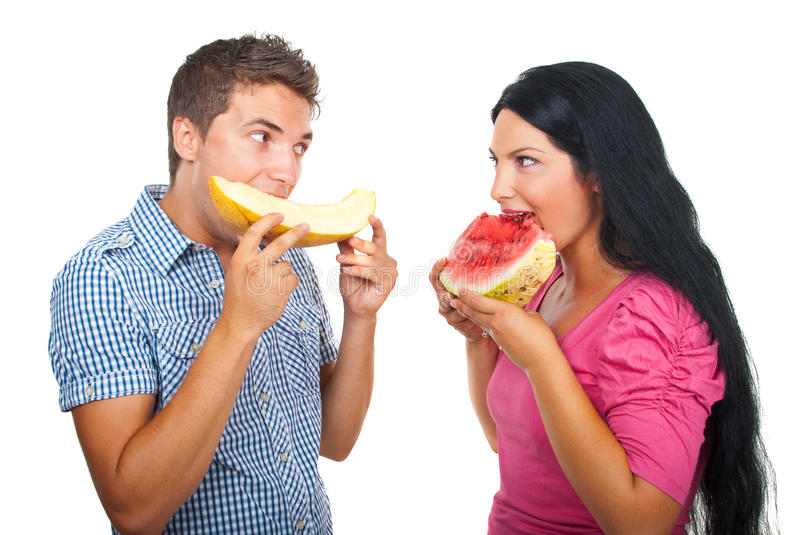Download Young couple eating melon stock photo. Image of hold - 15598148