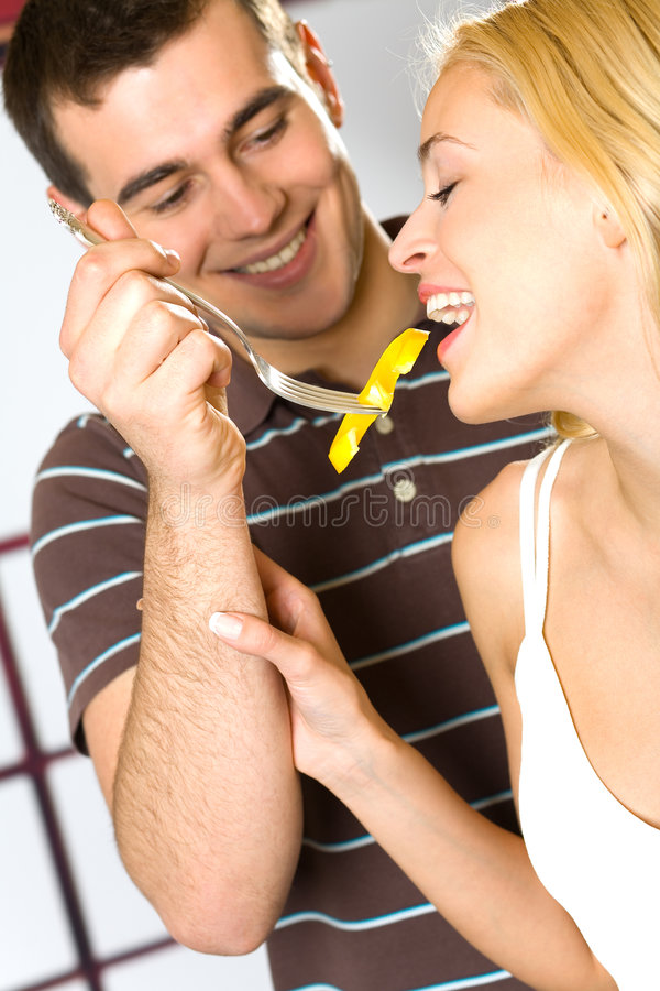 Young couple eating vegetable royalty free stock photography
