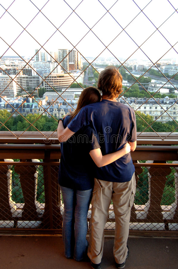 Download Young Couple On Eiffel Tower Stock Photo - Image of innocence, happy: 5637884