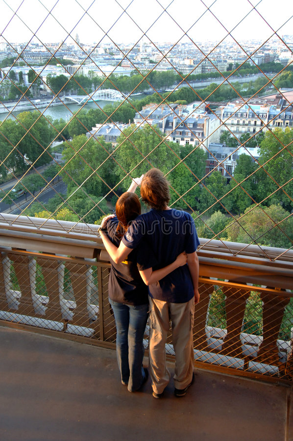Young couple on Eiffel tower stock photos