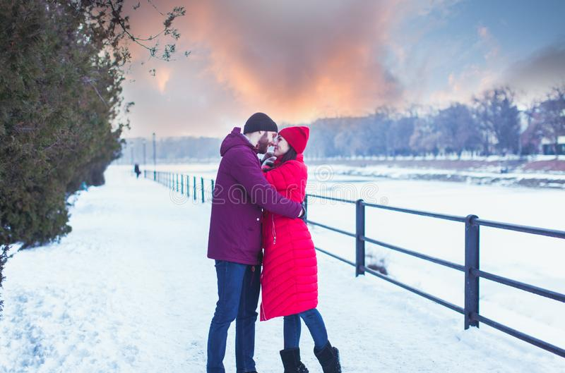 Young couple embracing during winter walk in city stock image
