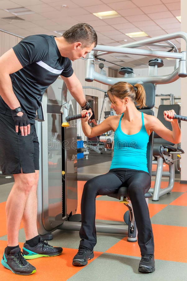Young couple engaged in the gym stock images