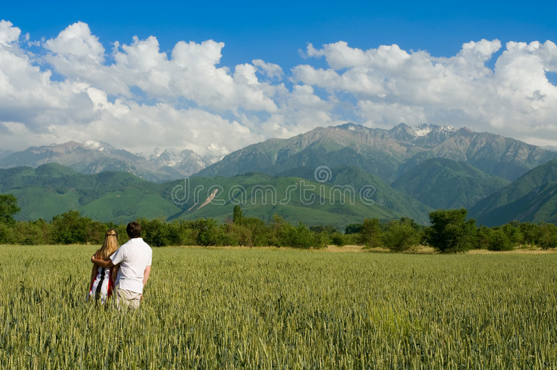 Young Couple Enjoing Beauty Of Nature Stock Image