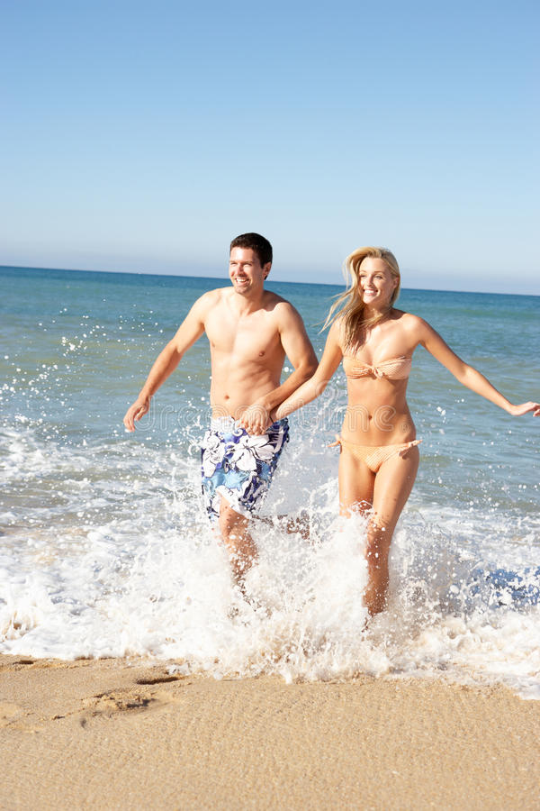 Download Young Couple Enjoying Beach Holiday Stock Image - Image: 16615363