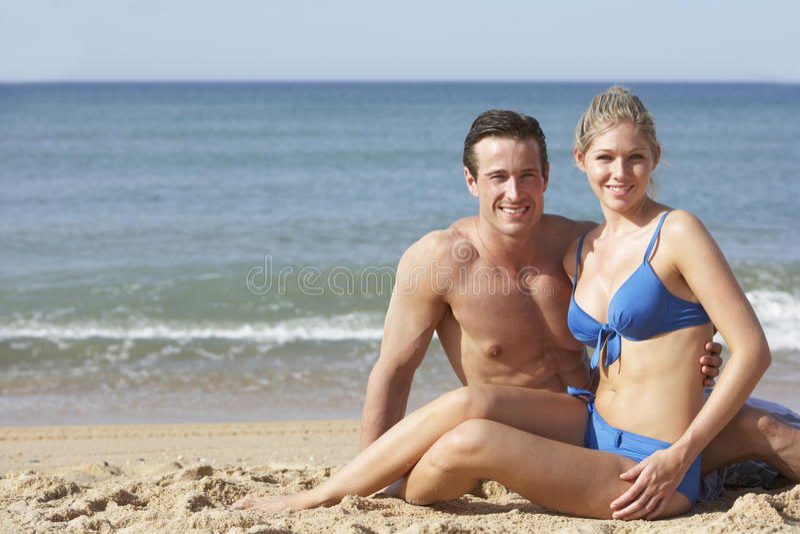 Young Couple Enjoying Beach Holiday royalty free stock image