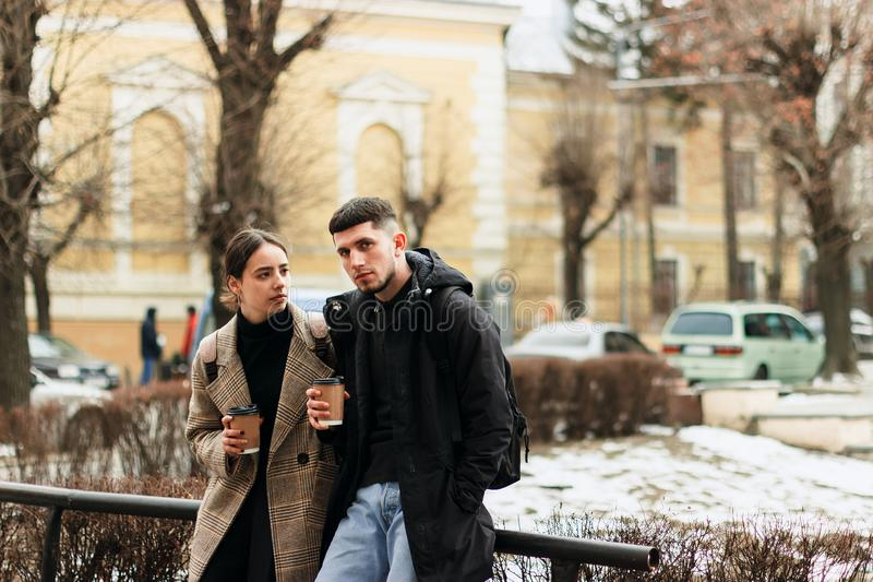 Young couple enjoying coffe outdoor in the city center royalty free stock image