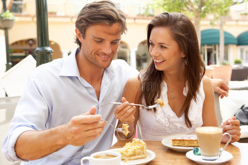 Young Couple Enjoying Coffee And Cake royalty free stock image
