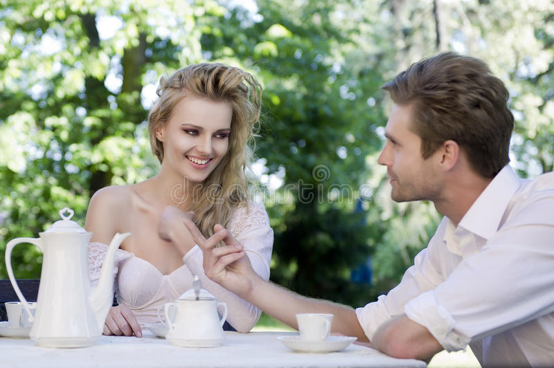 Young couple enjoying lunch in the garden stock photo