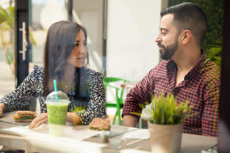 Young couple enjoying lunch royalty free stock photos