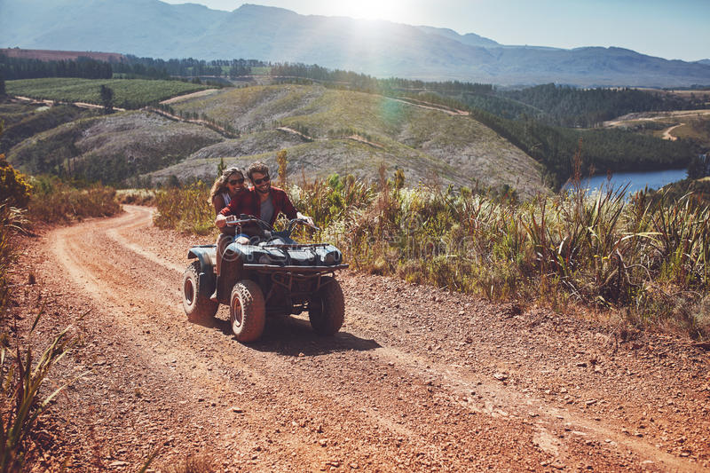 Young couple enjoying off road vehicle ride stock images