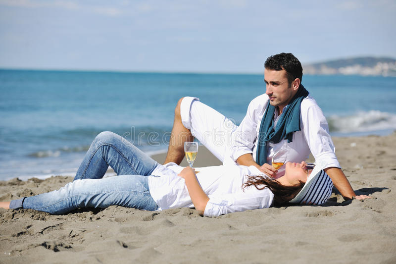 Download Young Couple Enjoying  Picnic On The Beach Stock Photo - Image: 17021874