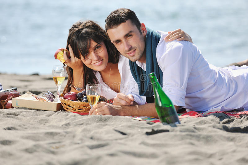 Download Young Couple Enjoying  Picnic On The Beach Stock Photo - Image: 17022456