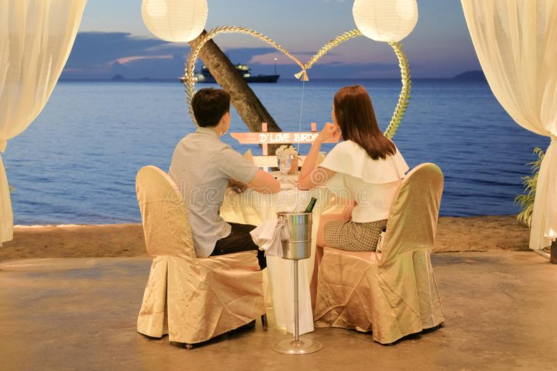 Loving couple eating romantic dinner by the beach stock photos
