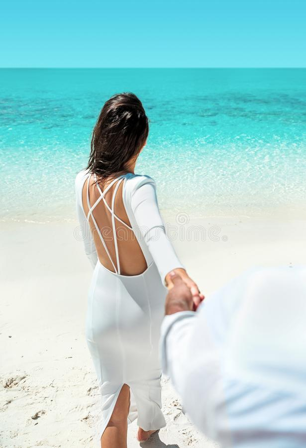 Young couple enjoying the romantic moment on a beach royalty free stock photos