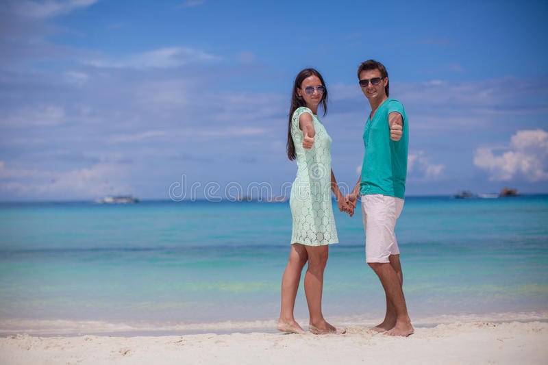 Young Couple Enjoying Summer Vacation And Showing Stock Photography