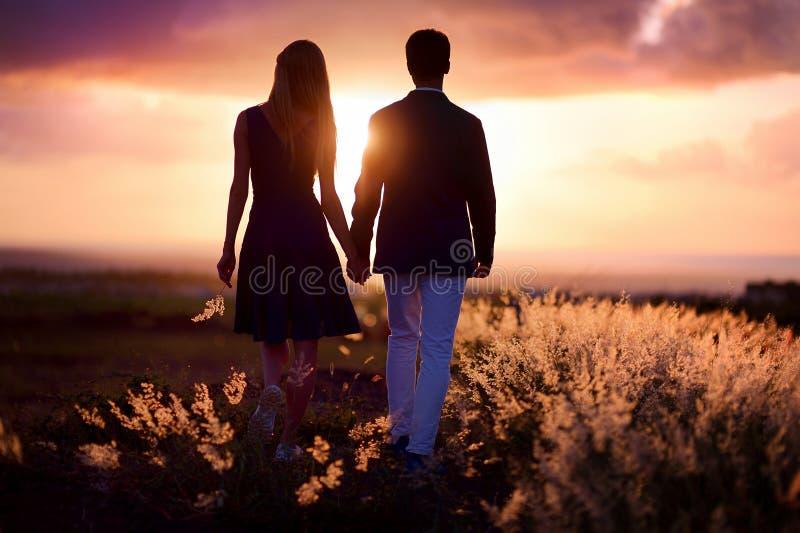 Young couple enjoying the sunset stock photos