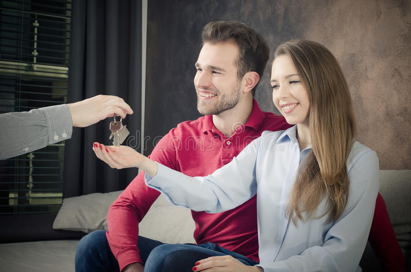 Young couple enjoys the purchase of own home. stock photo
