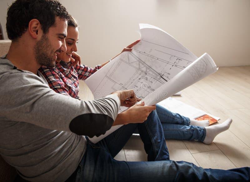 Young couple examining blueprints stock photos