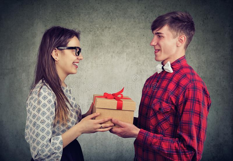 Young Couple exchanging with gift stock photography