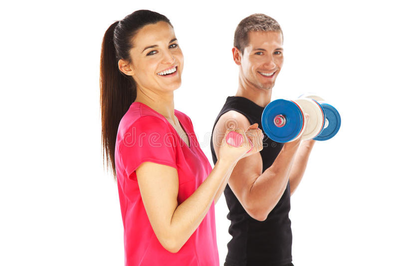 Young man and woman lifting weights. Isolated on white royalty free stock photography