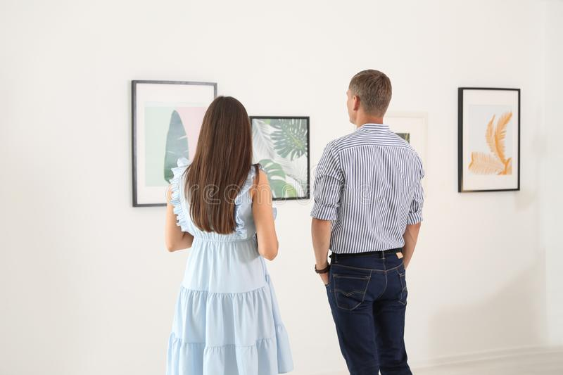 Young couple at exhibition royalty free stock photo