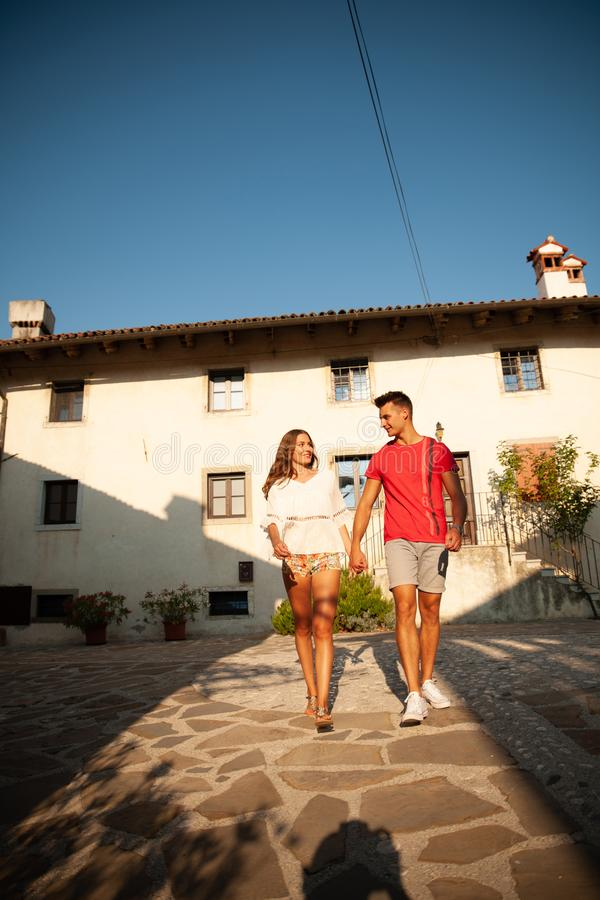 Young couple exploring ancient village Smartno in slovenia in ea. Rly summer royalty free stock photo