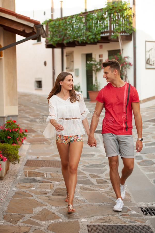 Young couple exploring ancient village Smartno in slovenia in ea. Rly summer stock photography