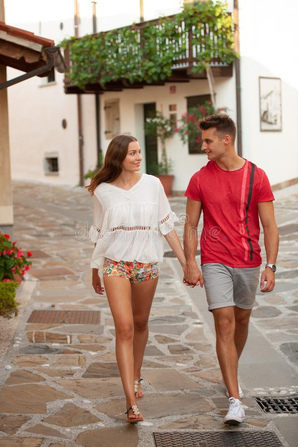 Young couple exploring ancient village Smartno in slovenia in ea. Rly summer stock image