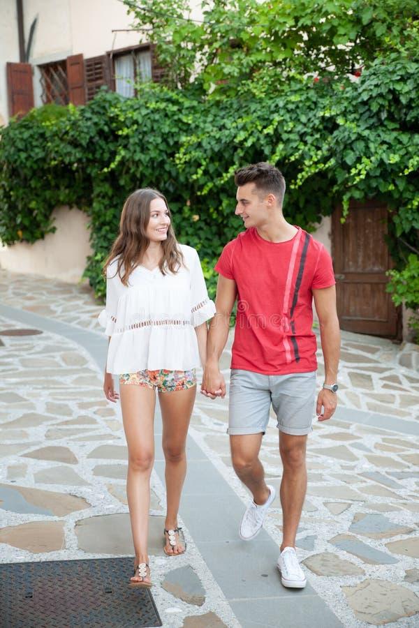 Young couple exploring ancient village Smartno in slovenia in ea. Rly summer royalty free stock photos