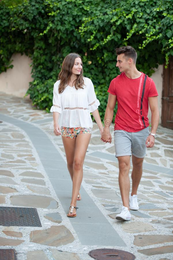 Young couple exploring ancient village Smartno in slovenia in early summer.  stock photography