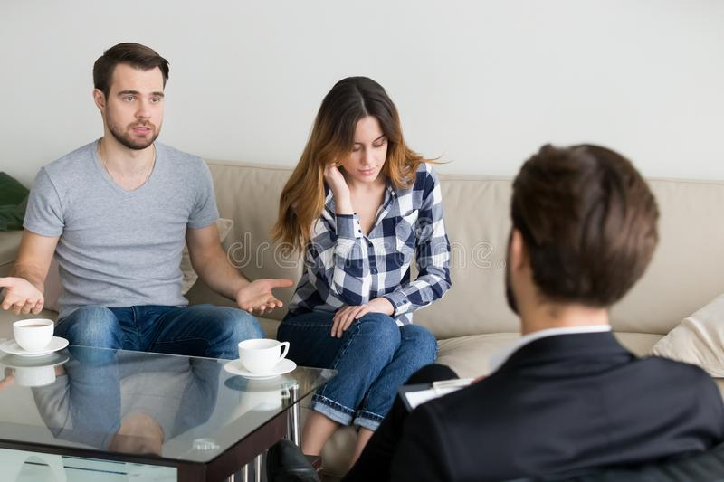 Young couple, family at meeting with psychologist counselor. Young couple, family at meeting session with psychologist counselor doctor. Family problems royalty free stock photos