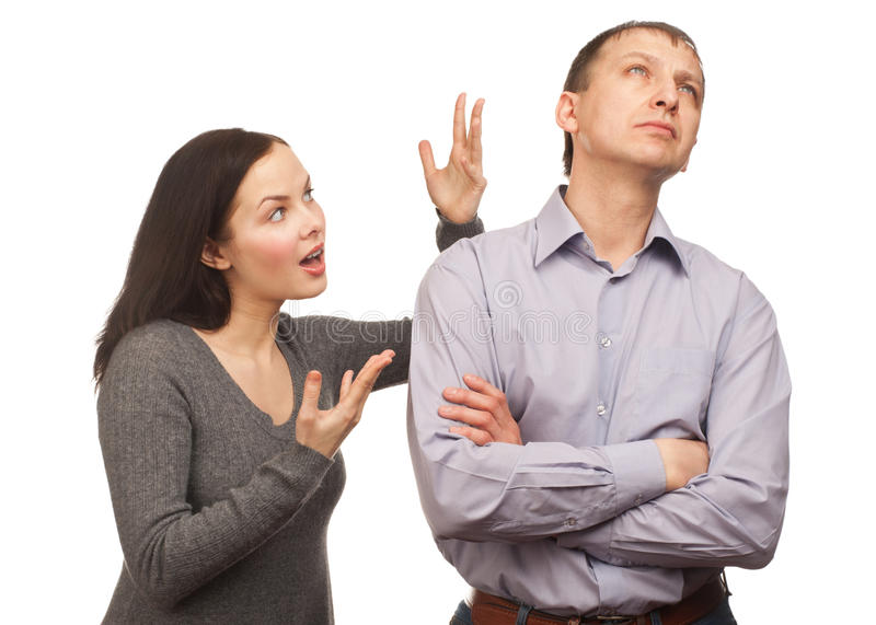 Young couple fighting. Young couple in quarrel. Wife yelling at her husband, isolated on white background royalty free stock photos