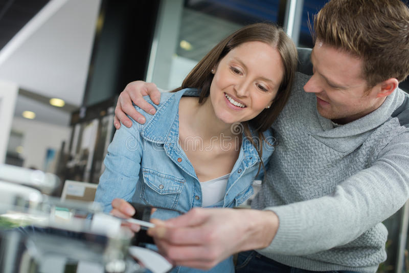 Young couple fixing devise at home. Young couple fixing a devise at home stock images