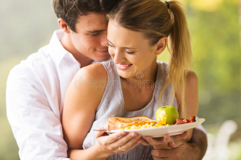 Young couple flirting. Cute young couple flirting during breakfast time stock photography