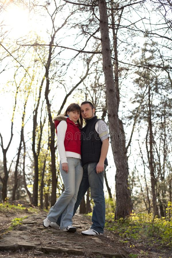 Download Young couple in a forest stock photo. Image of pair, people - 13952372
